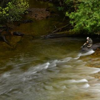 Switching flies. Small creek close to Yelcho lake.