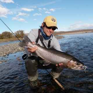 Gonzalo Flego, one of the guides of our staff with a big rainbow. Limay River.