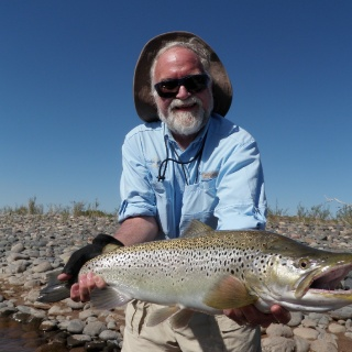 Our friend Bruce Dancik from Edmonton, Canada with a silver brown from Limay River