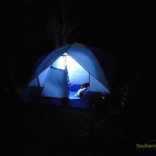Artificial light at Southernloops riverside camp.