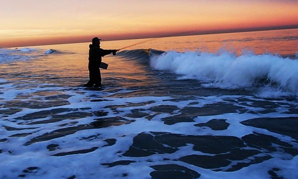 Hugh at dusk in the early November surf on the hunt for stripers.