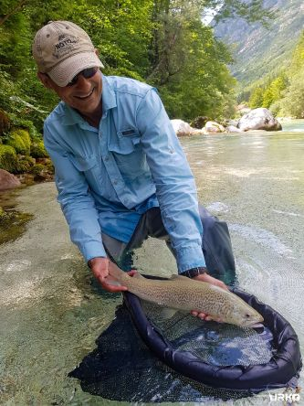 Mo with beautiful marble trout from the river Soča