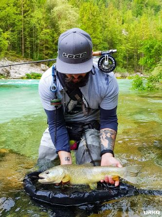 When dreams come true. Early morning at the upper Soča, first cast and the biggest marble trout for Marco.