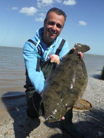 Lenguado pescado en la Albufera de Mar Chiquita con caña 7/8 línea de flote y Clouser Minnow verde/rojo en anzuelo 2/0